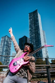 Photo shoot Autumn 2020 at Deansgate Square with my custom sparkly-pink Jackson guitar